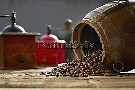 coffee beans and vintage grinder