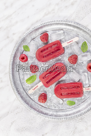 tasty fresh popsicles placed in the