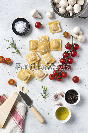 uncooked ravioli and different spices with