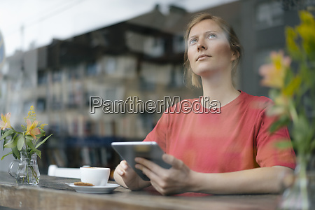 young woman using tablet at the