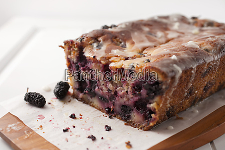 cut loaf of glazed mulberry yoghurt
