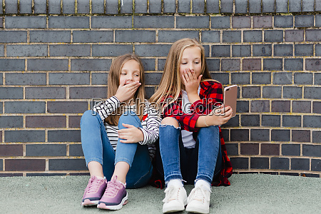 portrait of two girls sitting in