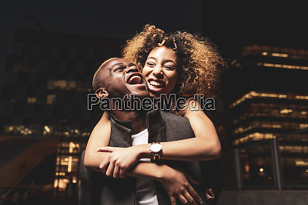 laughing young couple having fun at