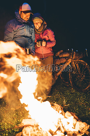 couple with with bikes standing at