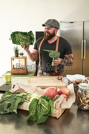 vegan man choosing vegetables in his