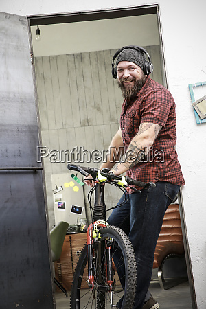 portrait of happy man with bicycle