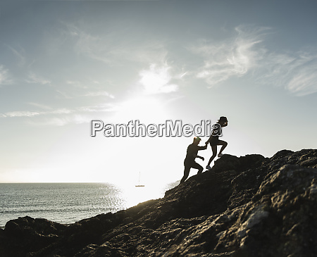 france brittany young couple climbing on