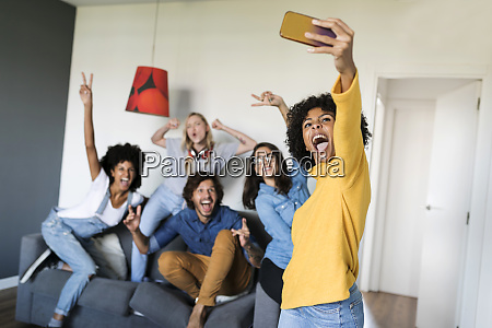 cheerful friends taking a selfie at