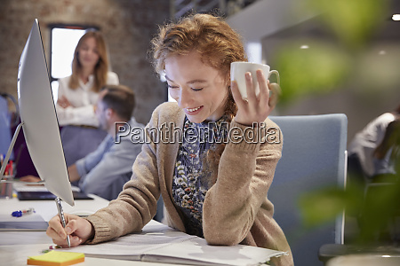 young woman working in modern creative