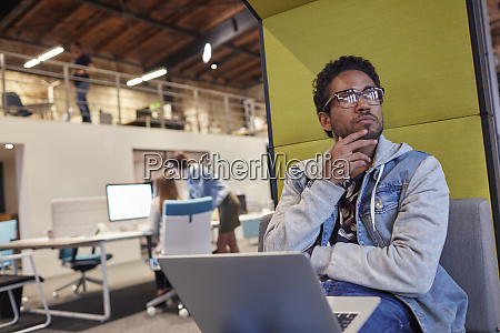 young man working in creative start