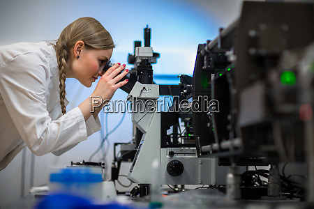 portrait of a female researcher carrying