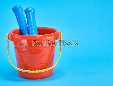 baby plastic red bucket on a