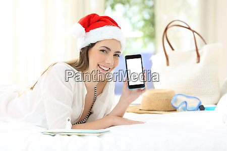 woman on christmas holidays showing a