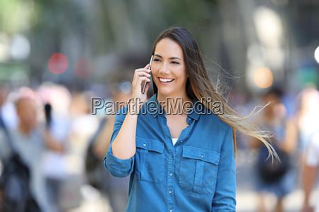 happy woman talks on phone in