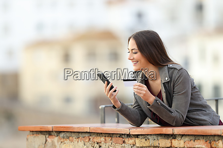 happy online buyer paying with phone