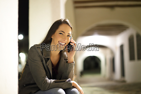 happy female talking on phone looking