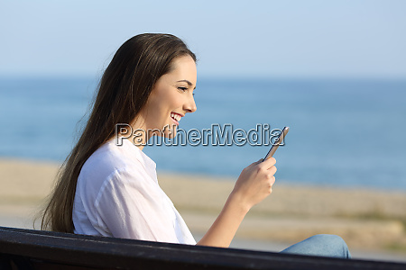 woman using a smart phone outdoors