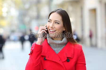 woman in red talking on phone