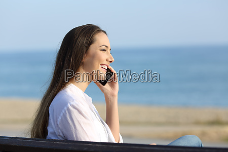 smiley lady talking on phone on