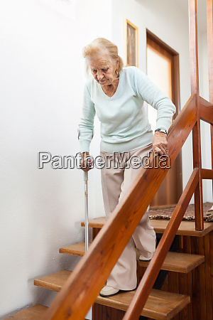 elderly woman at home using a