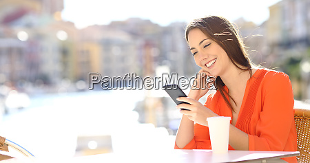 happy lady watching phone content in