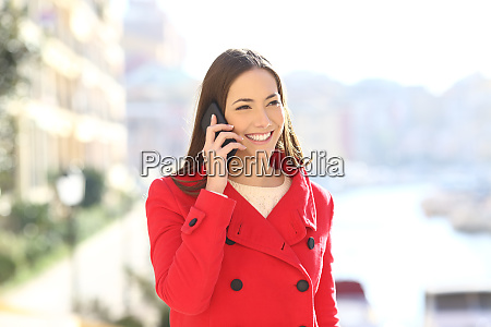 woman talking on phone in winter