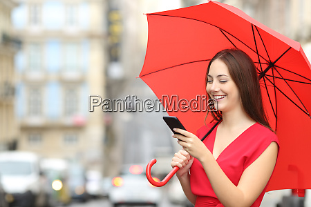 woman in red texting on a