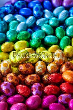bright chocolate eggs in rainbow colors