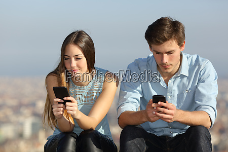 couple ignoring each other addicted to