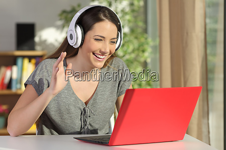 woman greeting in a video conference