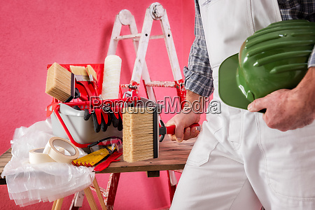 professional house painter at work on