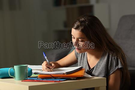 studious student doing homework late hours