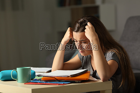 studious student studying hard in the