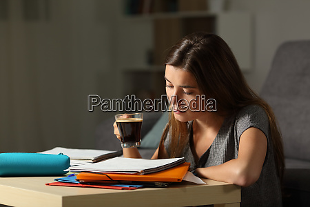 studious student studying holding a coffee
