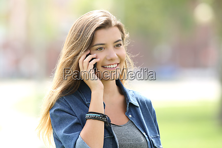teen girl calling on phone outdoors