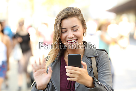 teen greeting during a videocall