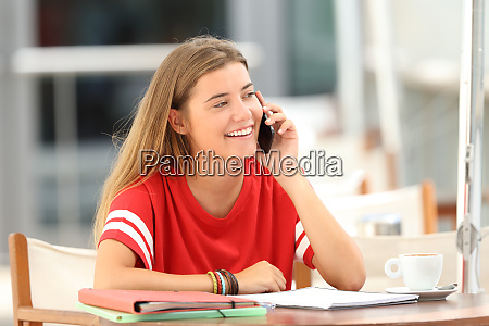 happy student talking on phone in