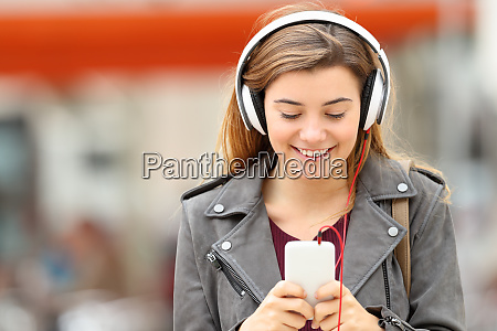 woman listening music with headphones and
