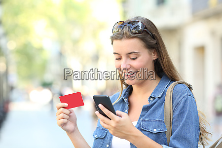 woman paying online with a credit