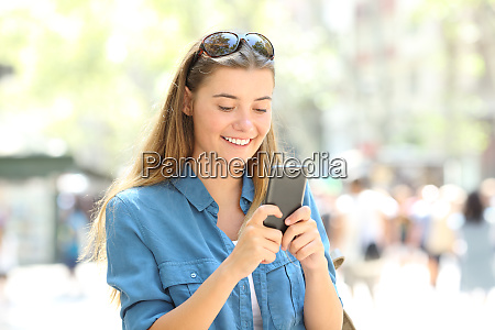 woman smiling using a mobile phone