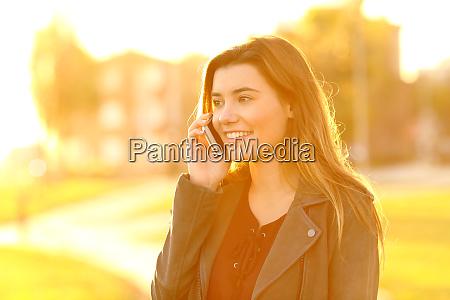 teenage girl talking on phone at