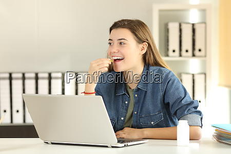 intern taking a vitamin pill at