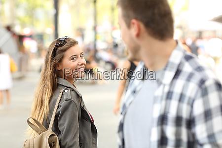 strangers girl and guy flirting on