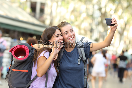 backpacker friends taking selfie with a