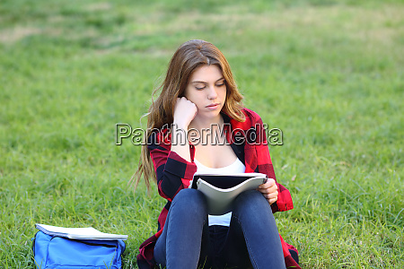 serious student studying reading notes on