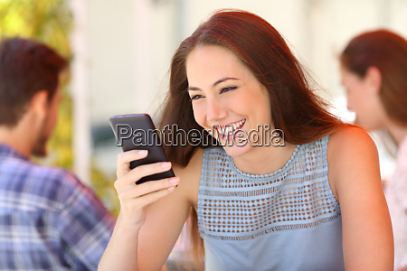 happy woman reading message on phone
