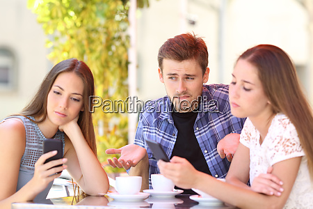 man being ignored by his friends