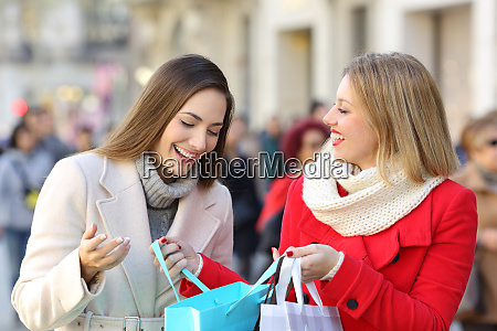two women shooping on the street