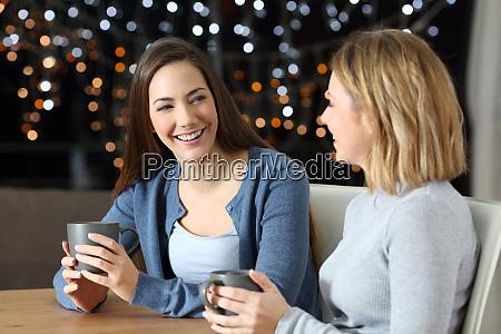 two happy friends talking in the