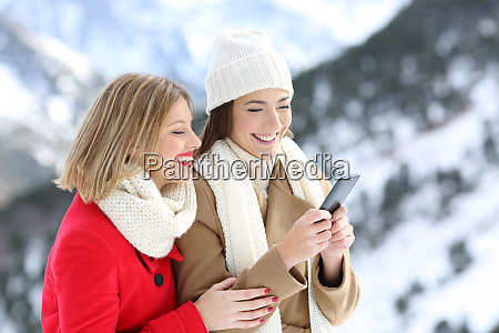 two friends using a smart phone